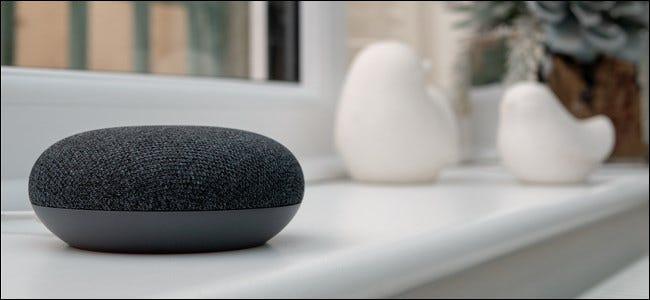 google home mini sitting on a window sill - آموزش ارسال پیام های متنی با گوگل اسیستنت